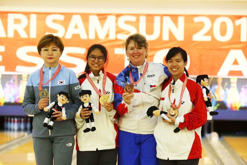 Adelia Naomi Yokoyama scores a gold while Kimberly Quek Hwee finishes bronze in the same event